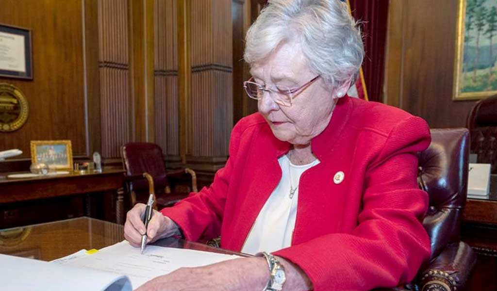 Kay Ivey signs the Alabama abortions bill
